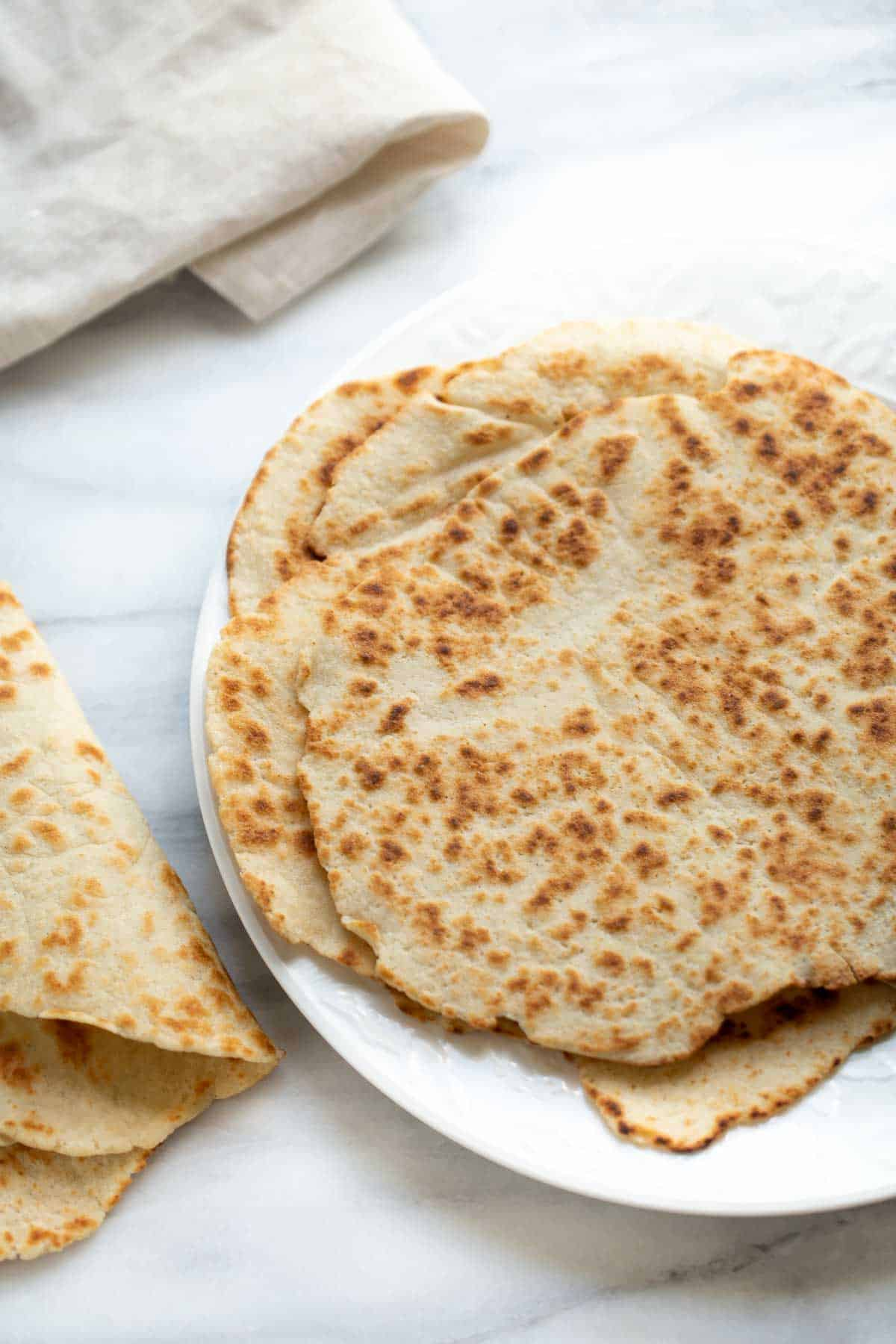 gluten-free flatbread on white plate with marble background