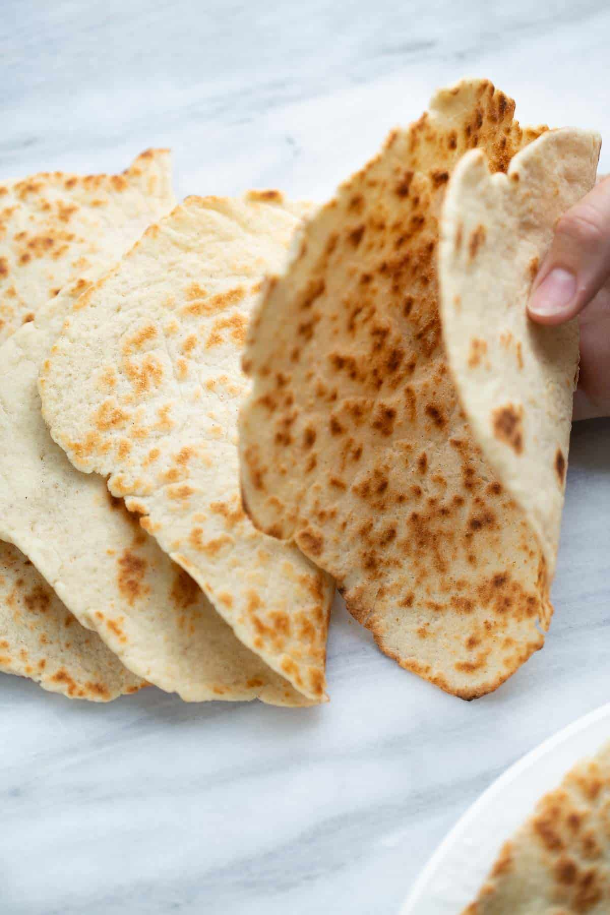 flatbread folded in half with marble background