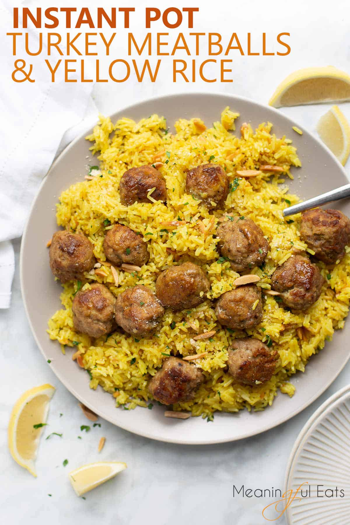 image for pinterest of meatballs and rice on gray plate with marble background