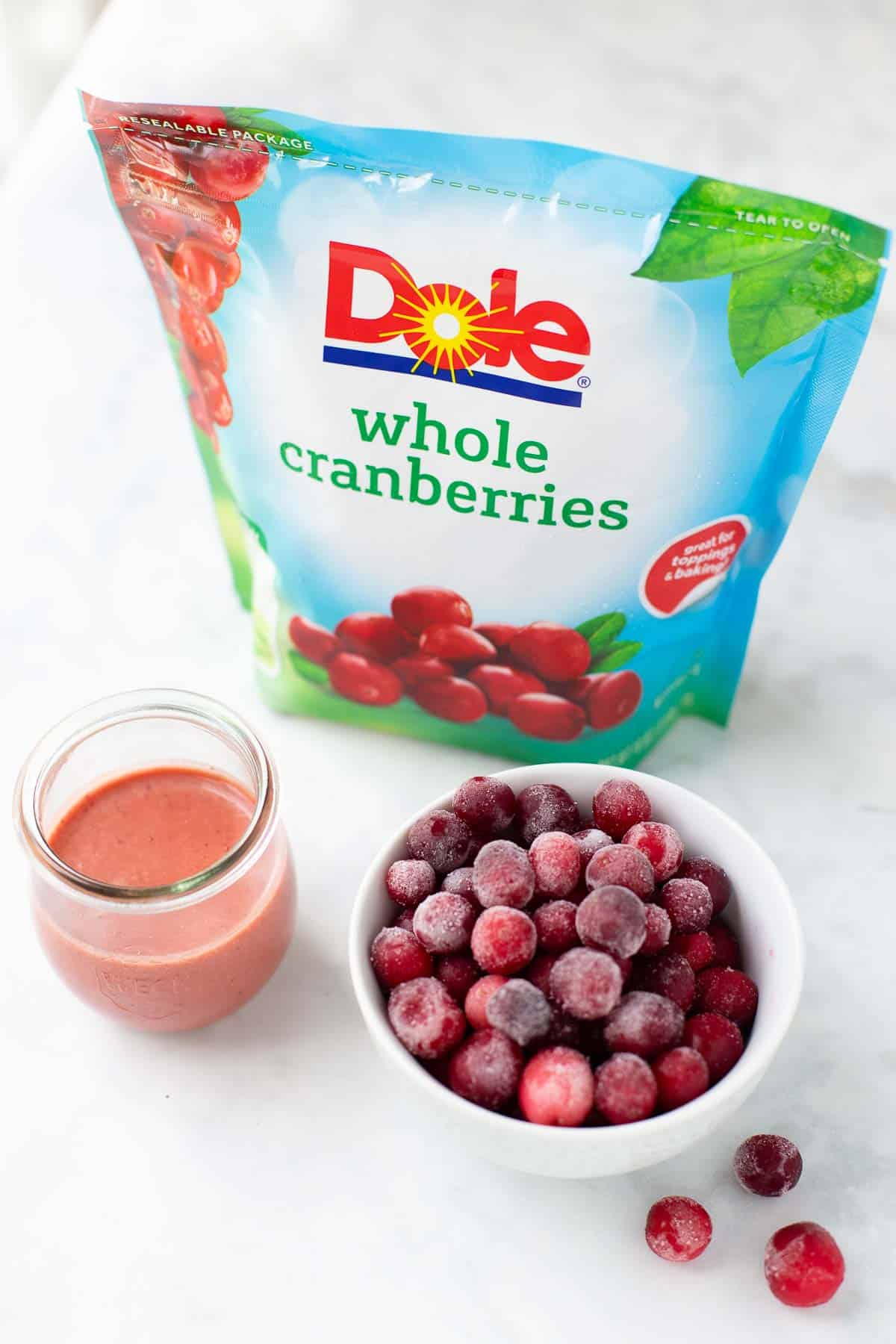 dole frozen cranberries and jar of salad dressing