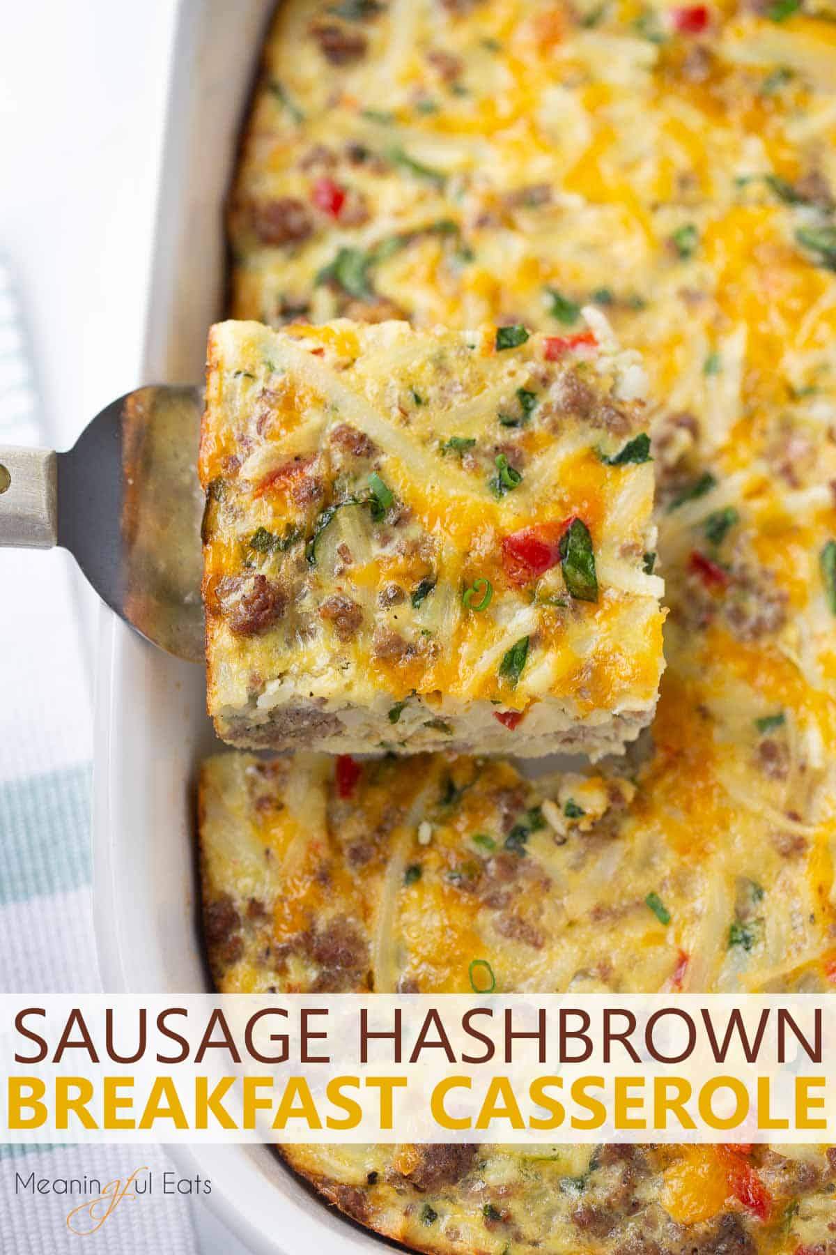 image for pinterest - breakfast casserole being served from white casserole dish with spatula