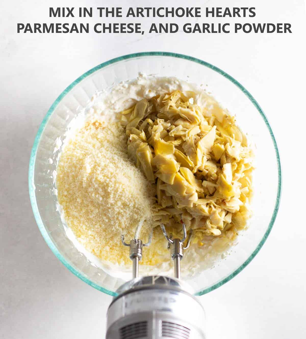 adding parmesan cheese and artichoke hearts to glass bowl to mix together