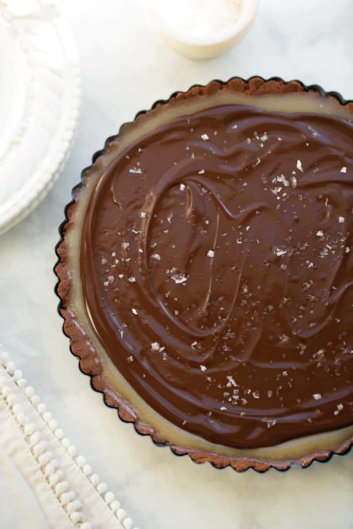 close up shot of chocolate caramel tart in pan
