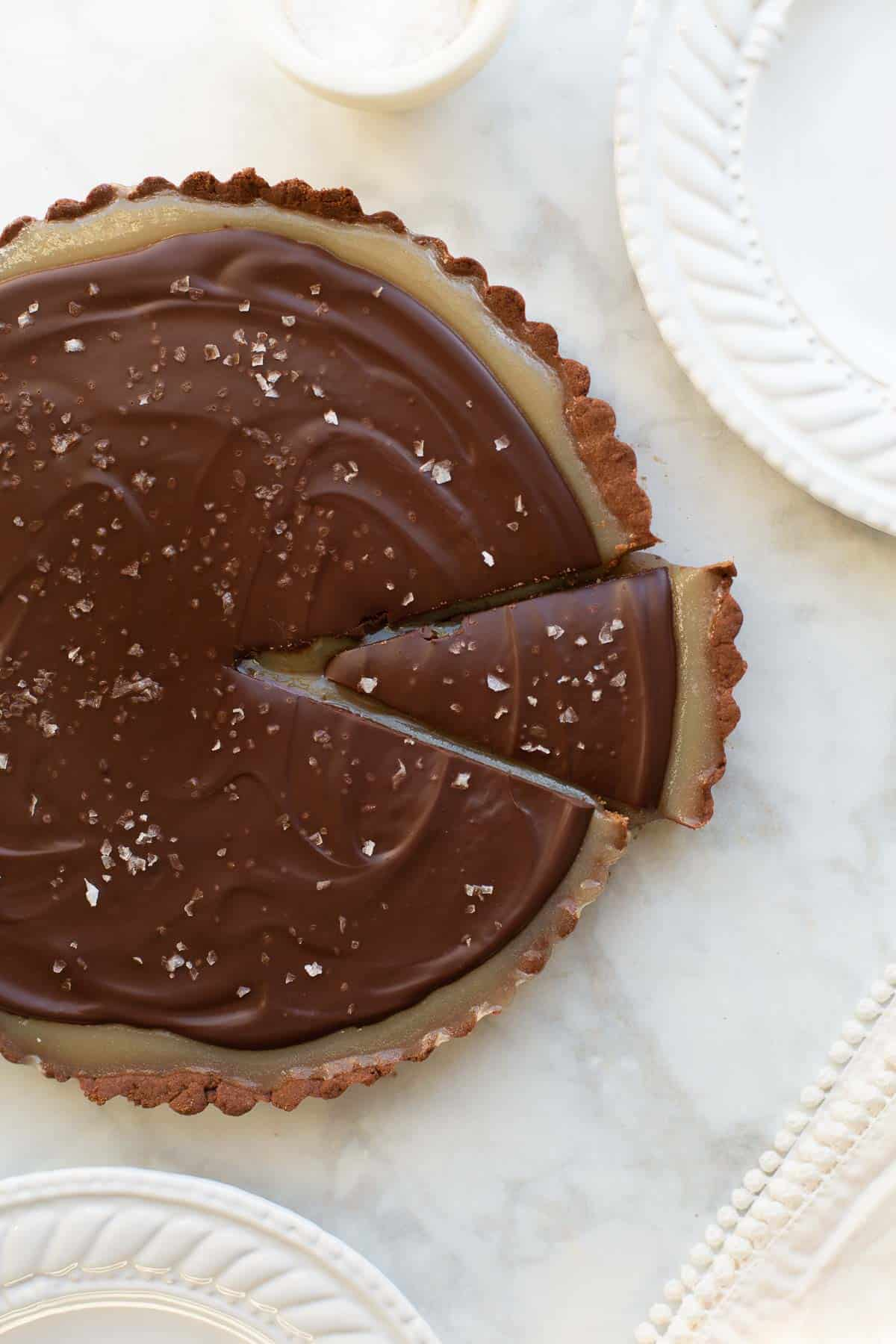 chocolate caramel tart with slice