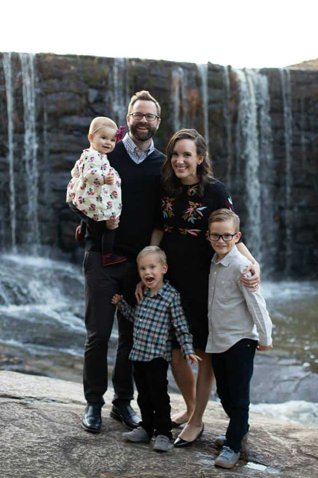 picture of family by a waterfall