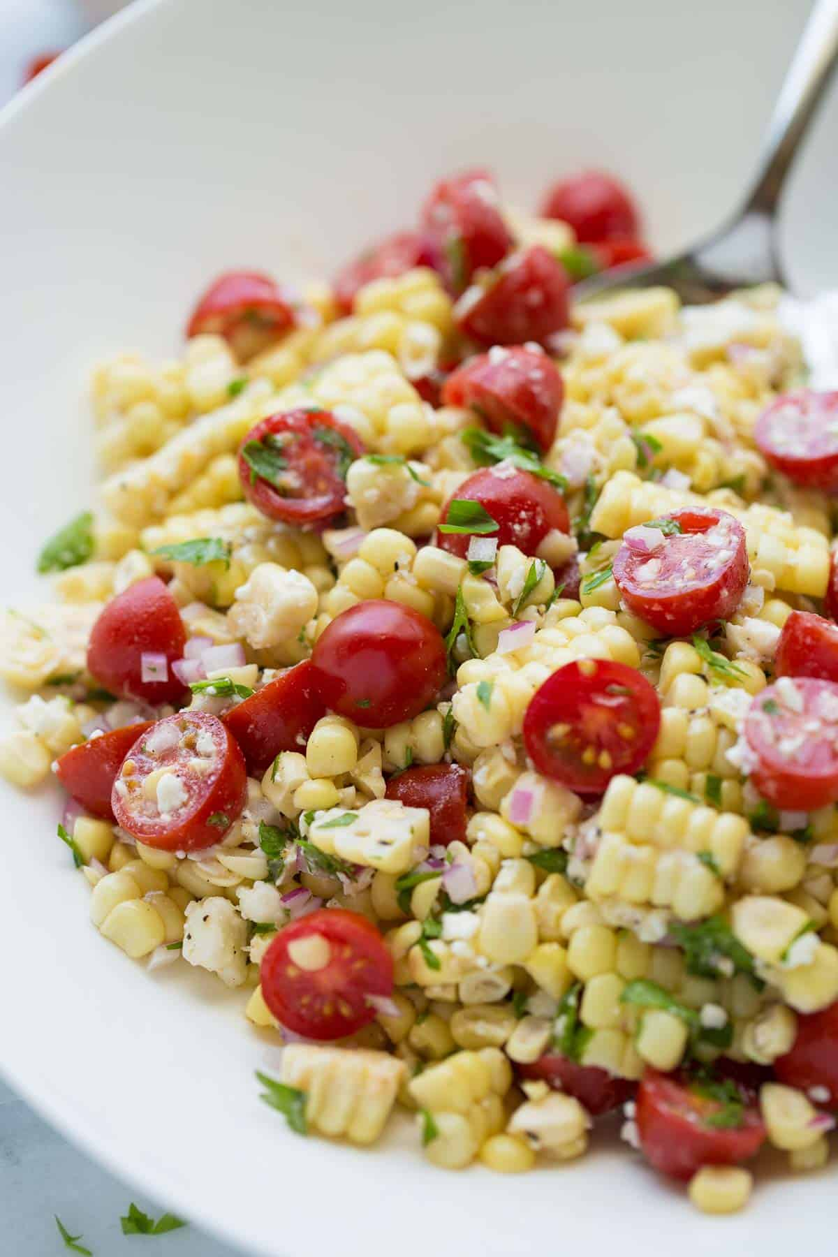 up close shot of corn salad in white bowl