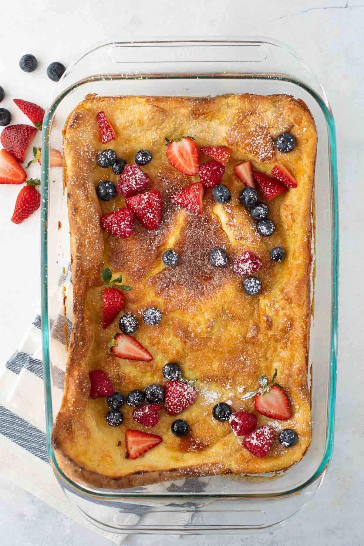overhead shot of gluten-free german pancake in pan with berries