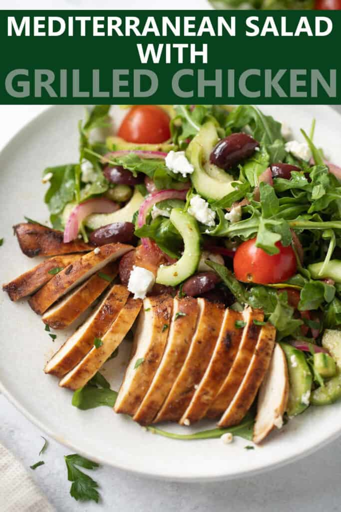 image for pinterest of grilled greek chicken salad on white plate