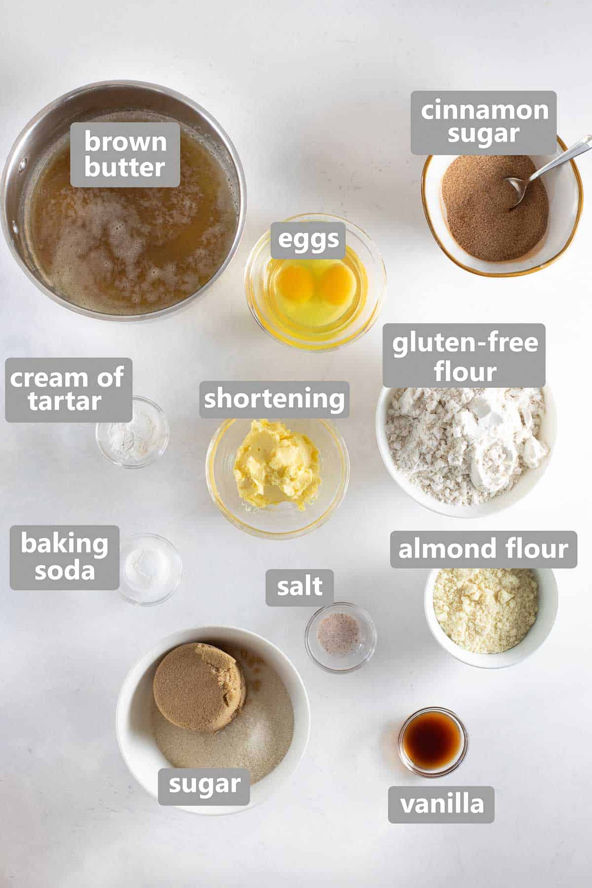 overhead shot of ingredients set out in bowls to make gluten-free snickerdoodles