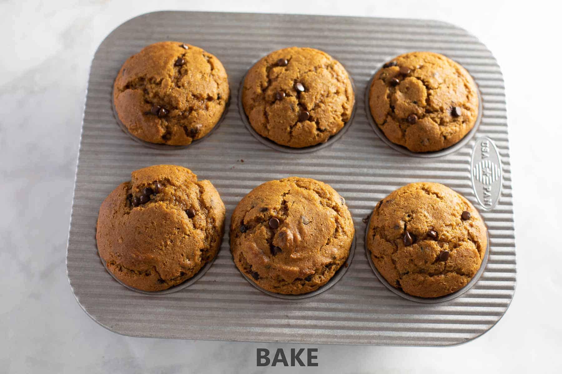 baked pumpkin muffins in muffin tin