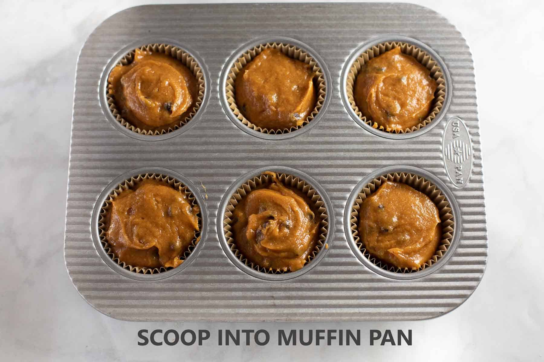 muffin batter scooped into pan before baking
