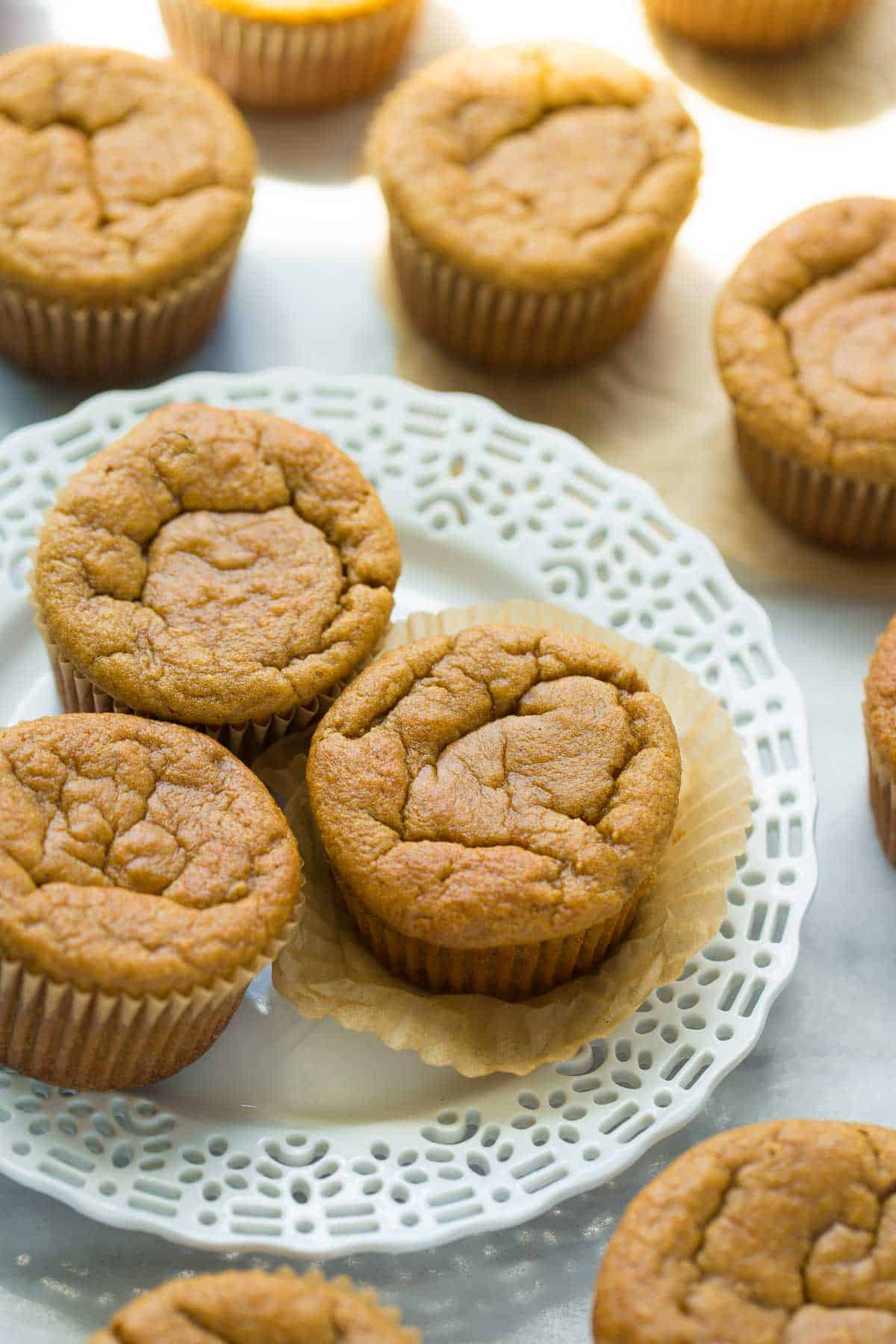 muffins on white plate with marble background