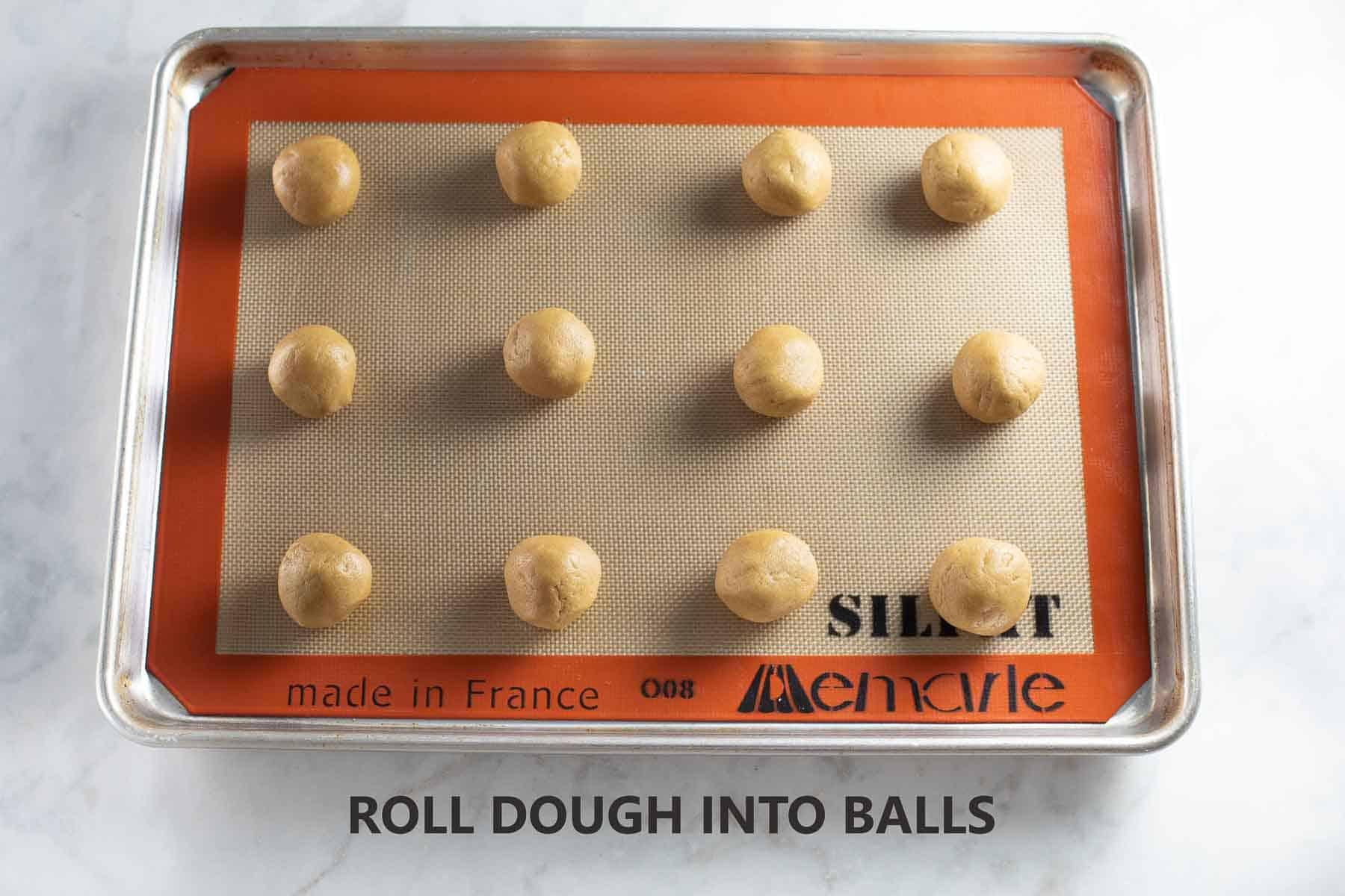 rolled dough balls on baking sheet
