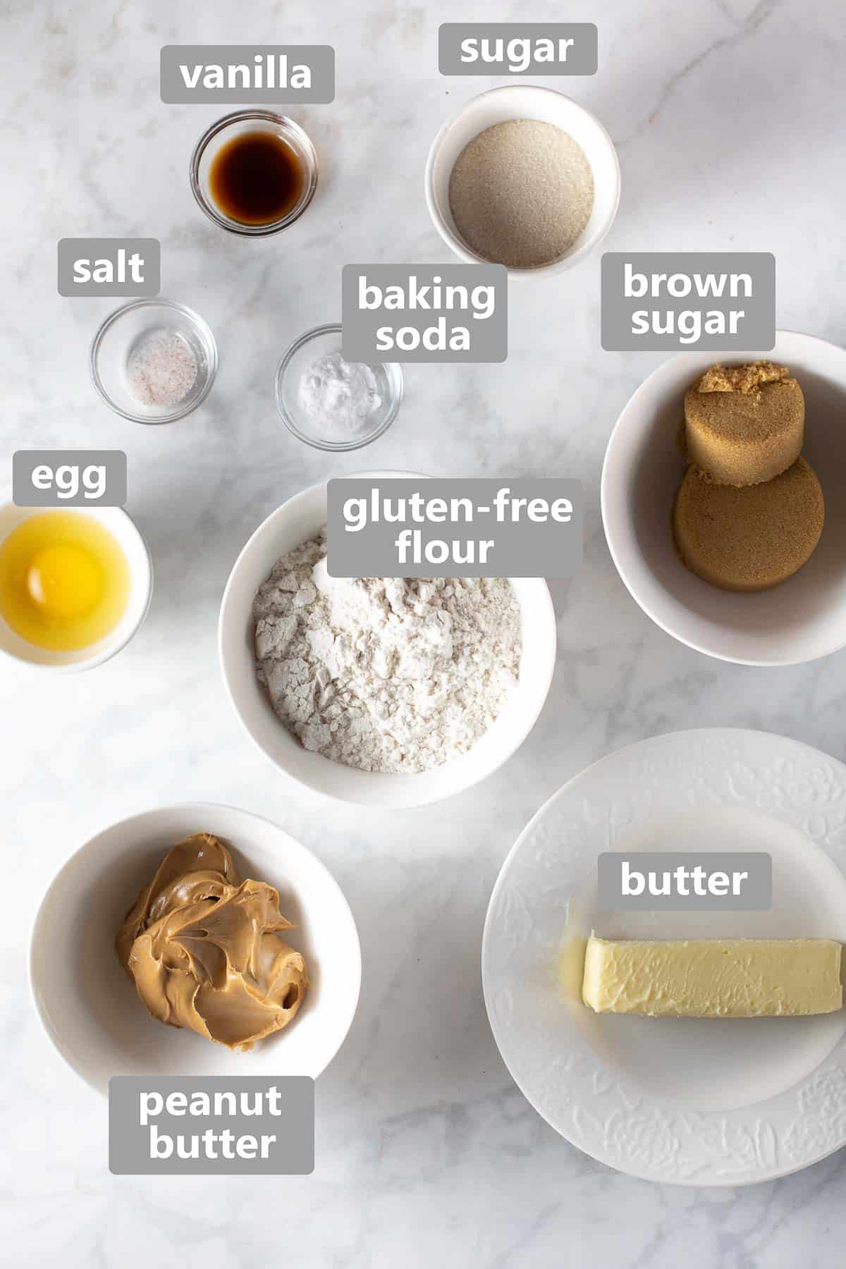 shot of ingredients set out on marble background in bowls to show what is used to make the cookies
