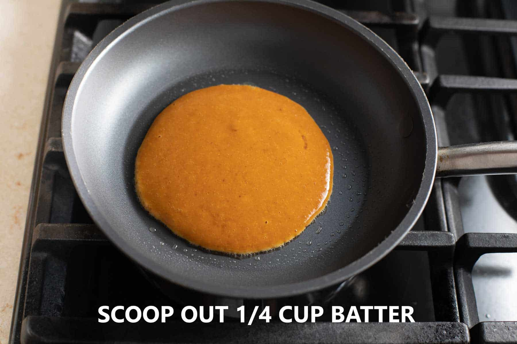 pancake batter poured into nonstick pan