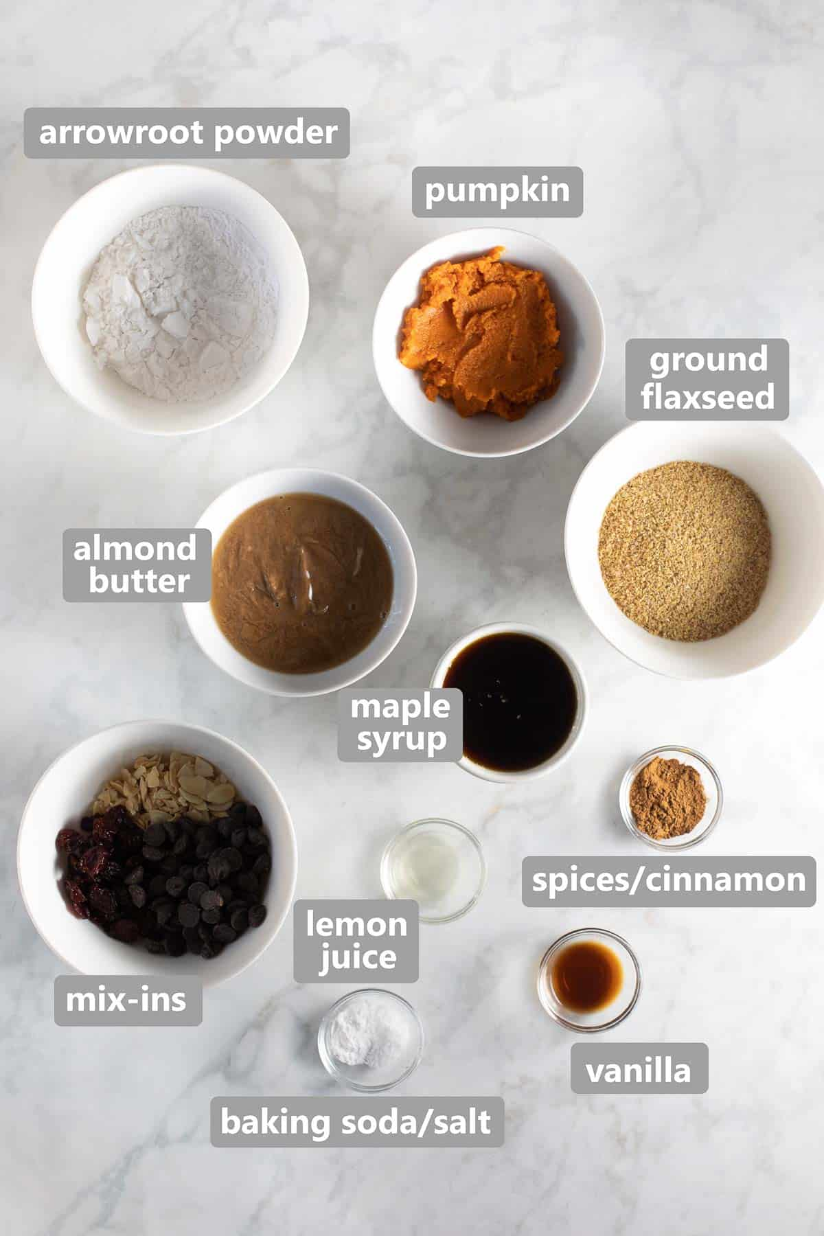 overhead shot of ingredients needed to make the cookies set out in bowls