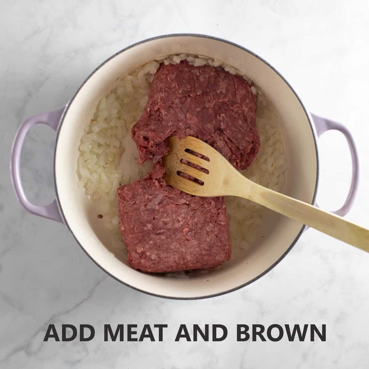 adding meat to pot to break up and brown