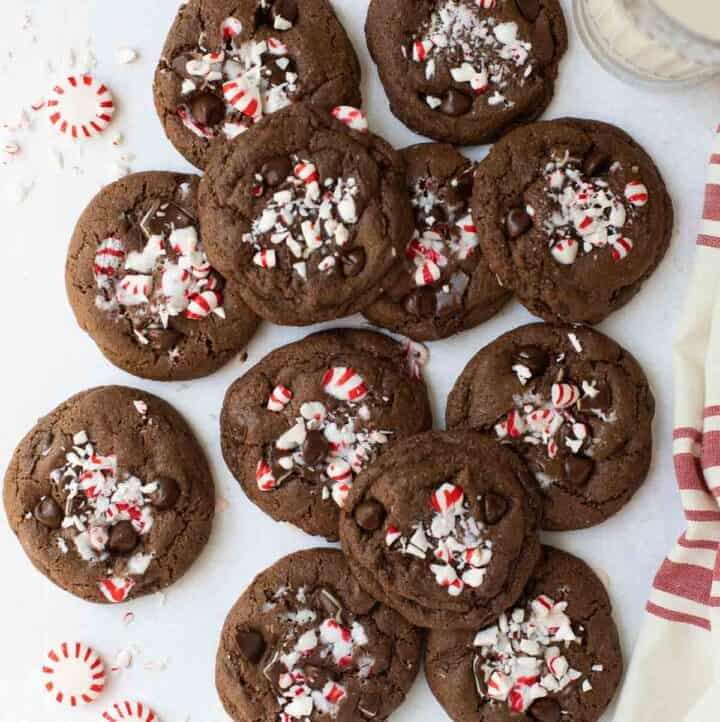 overhead shot of chocolate cookies with peppermint candy and red and white napkin