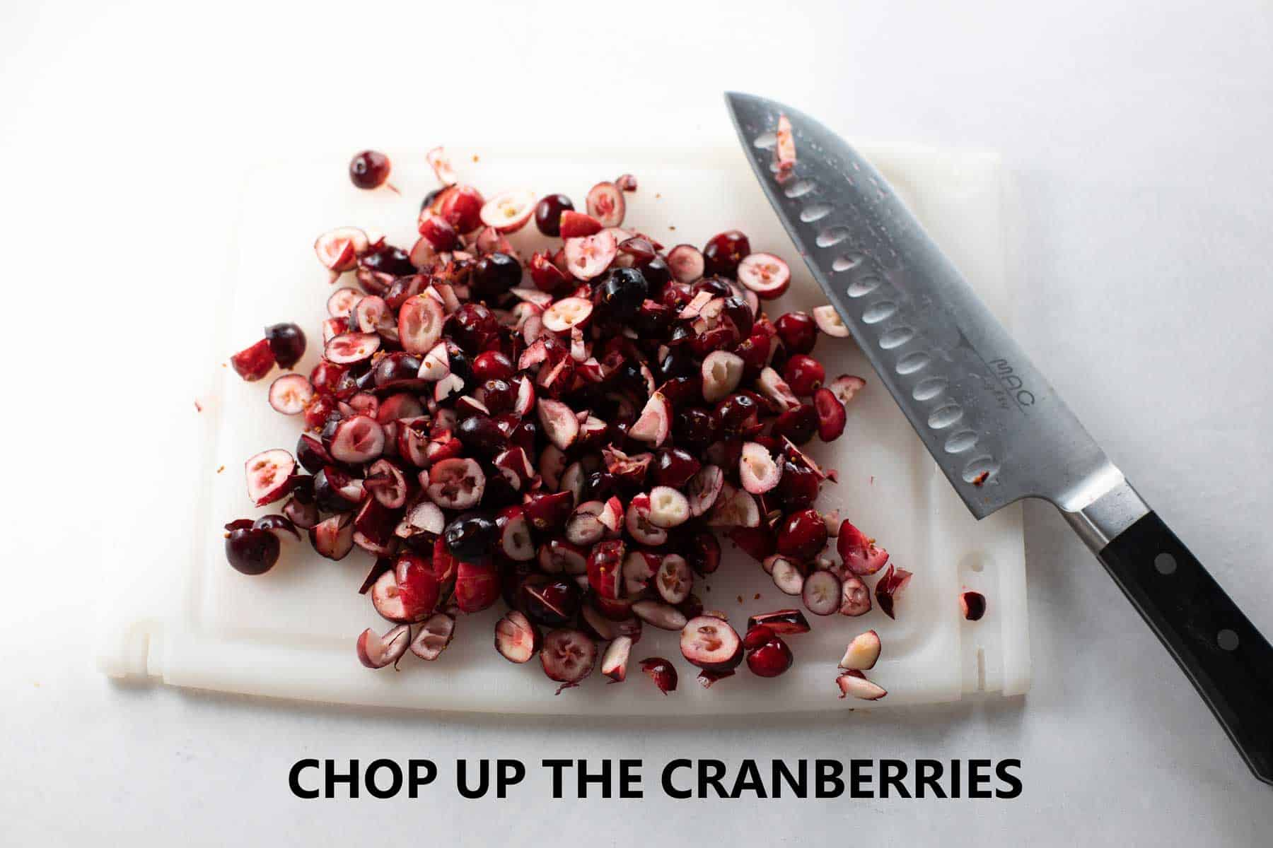 cranberries chopped on cutting board