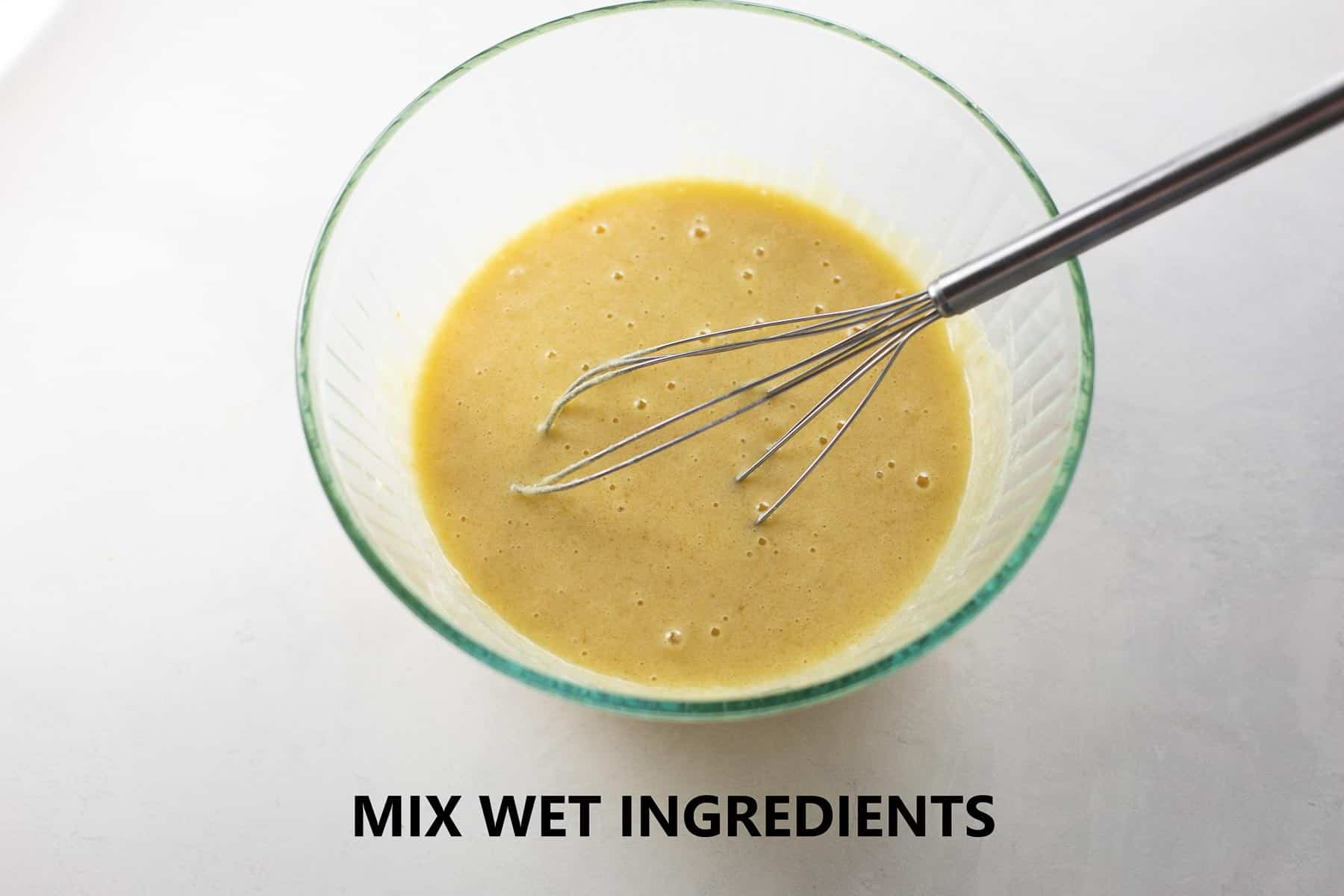 wet ingredients mixed together in glass bowl