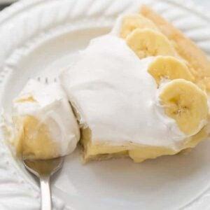 gluten free banana cream pie on white plate with fork