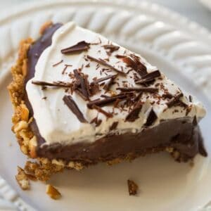 chocolate pie on white plate with pretzel crust