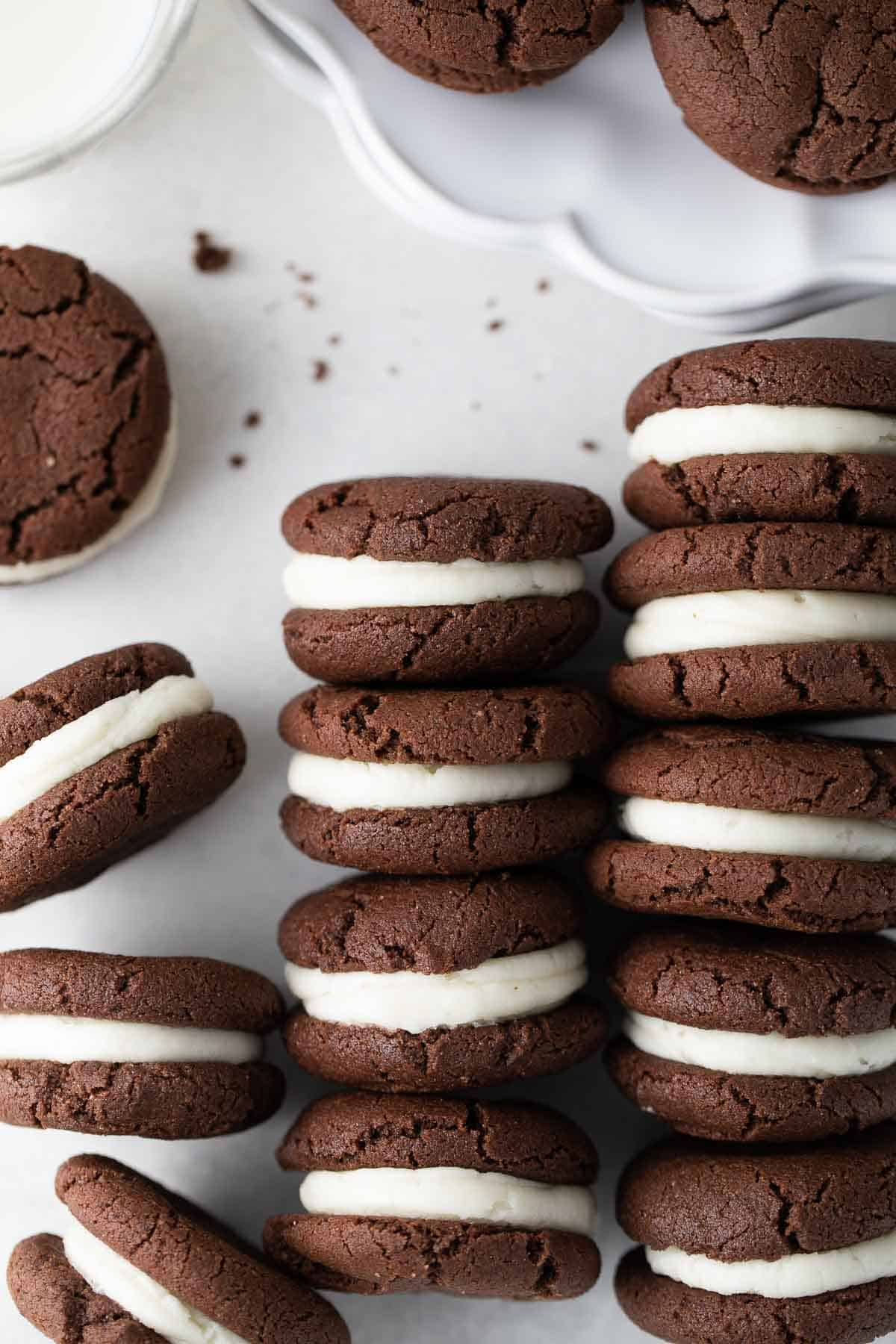gluten free oreo cookies with cream filling stacked in rows on white background