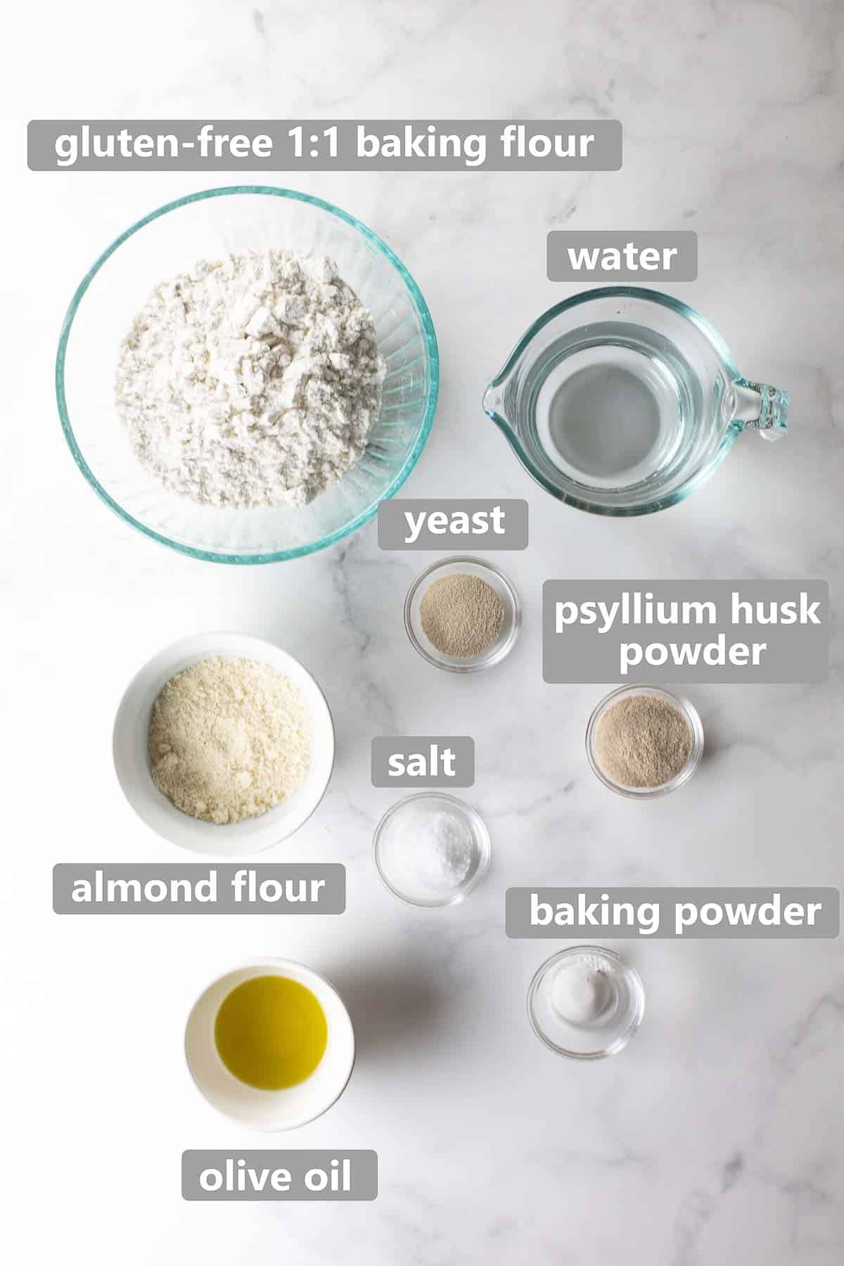 overhead shot of ingredients used to make gluten-free pizza crust on marble background