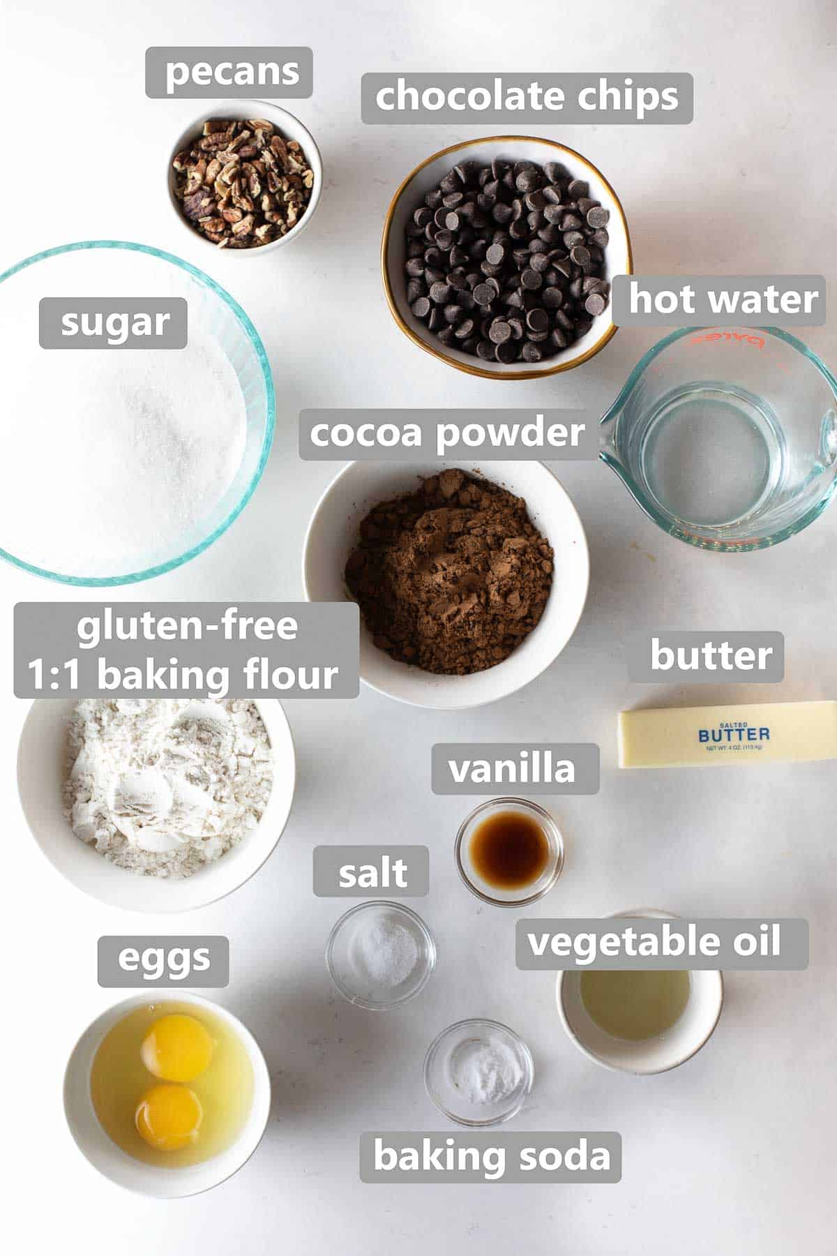 overhead shot of labeled ingredients to make gluten free brownies on marble background