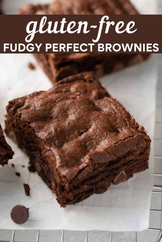 image for pinterest close up shot of gluten free brownie on white parchment paper