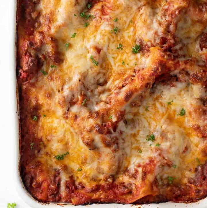 close up overhead shot of gluten free lasagna in white baking dish
