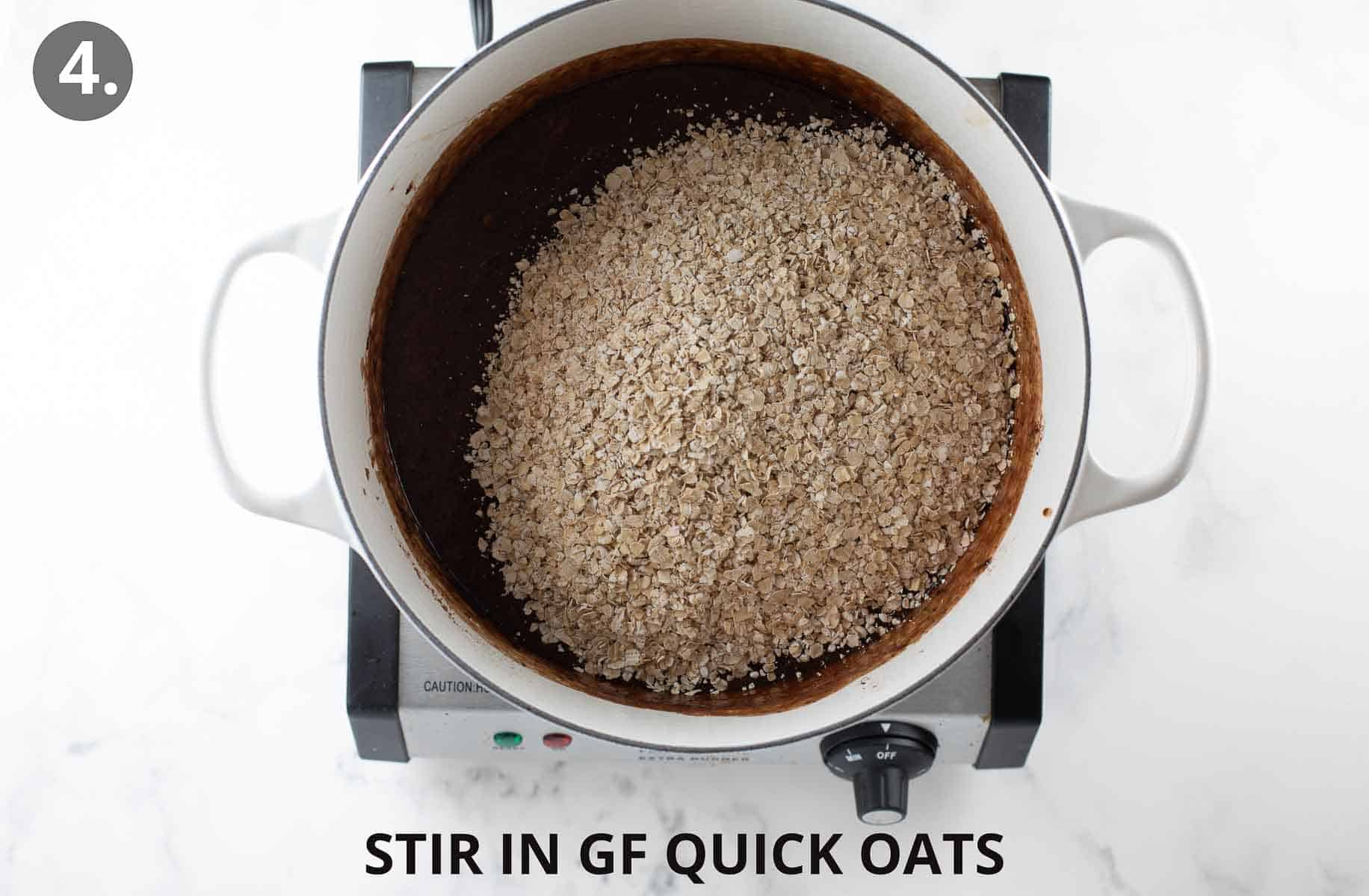 adding oats to the chocolate mixture in a white pot