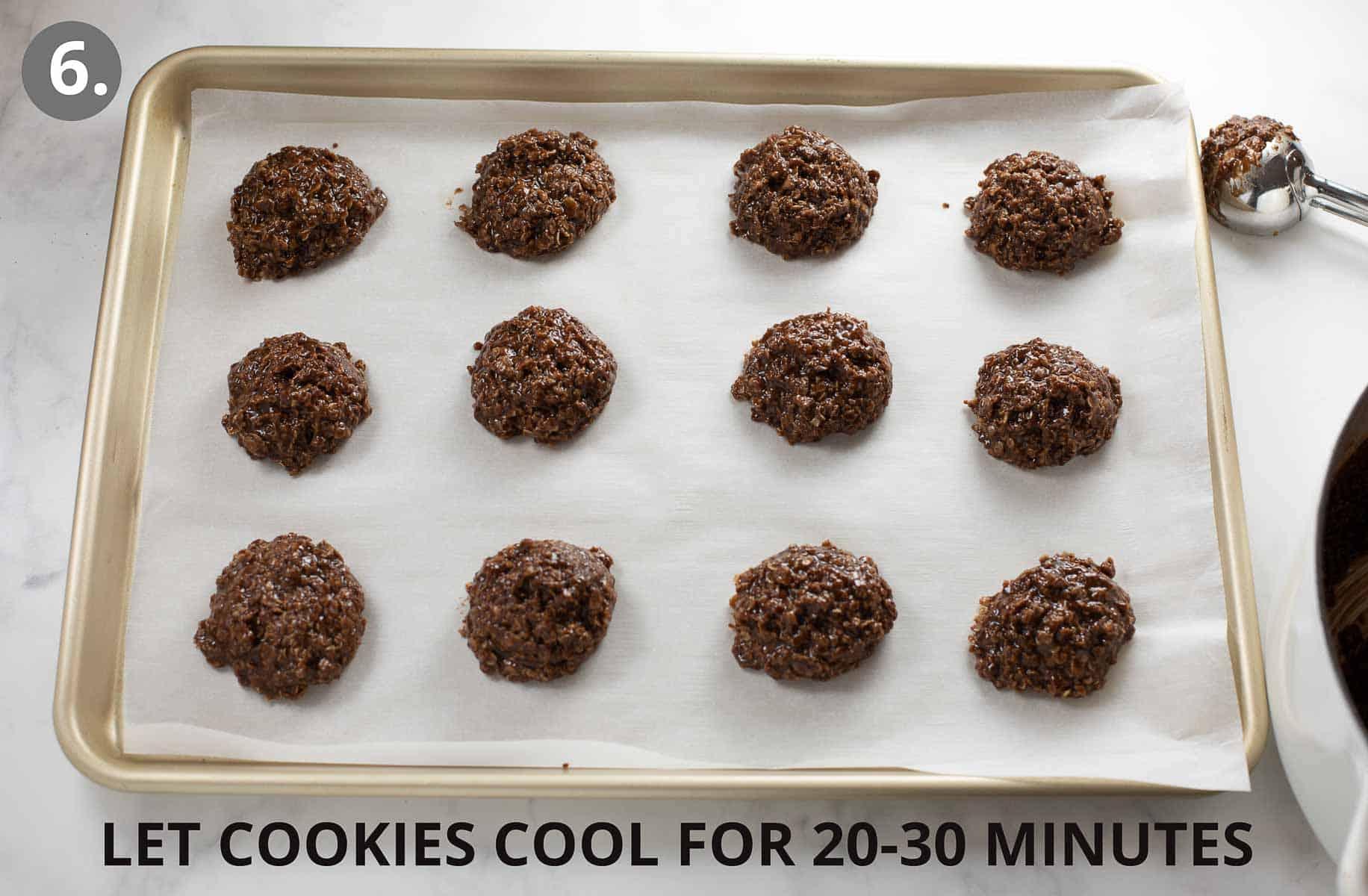 no bake cookies cooling on a baking sheet