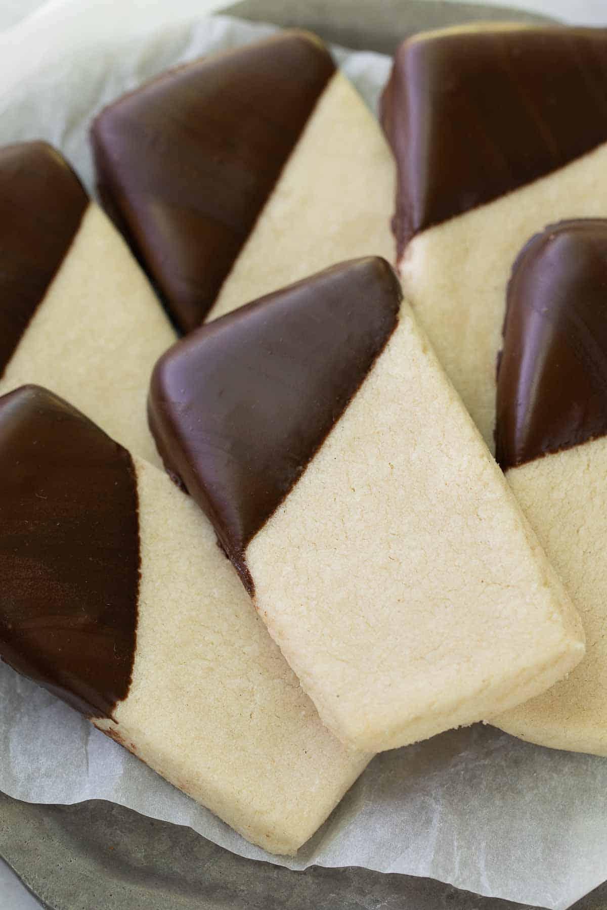 gluten free shortbread cookie dipped in chocolate on metal pan