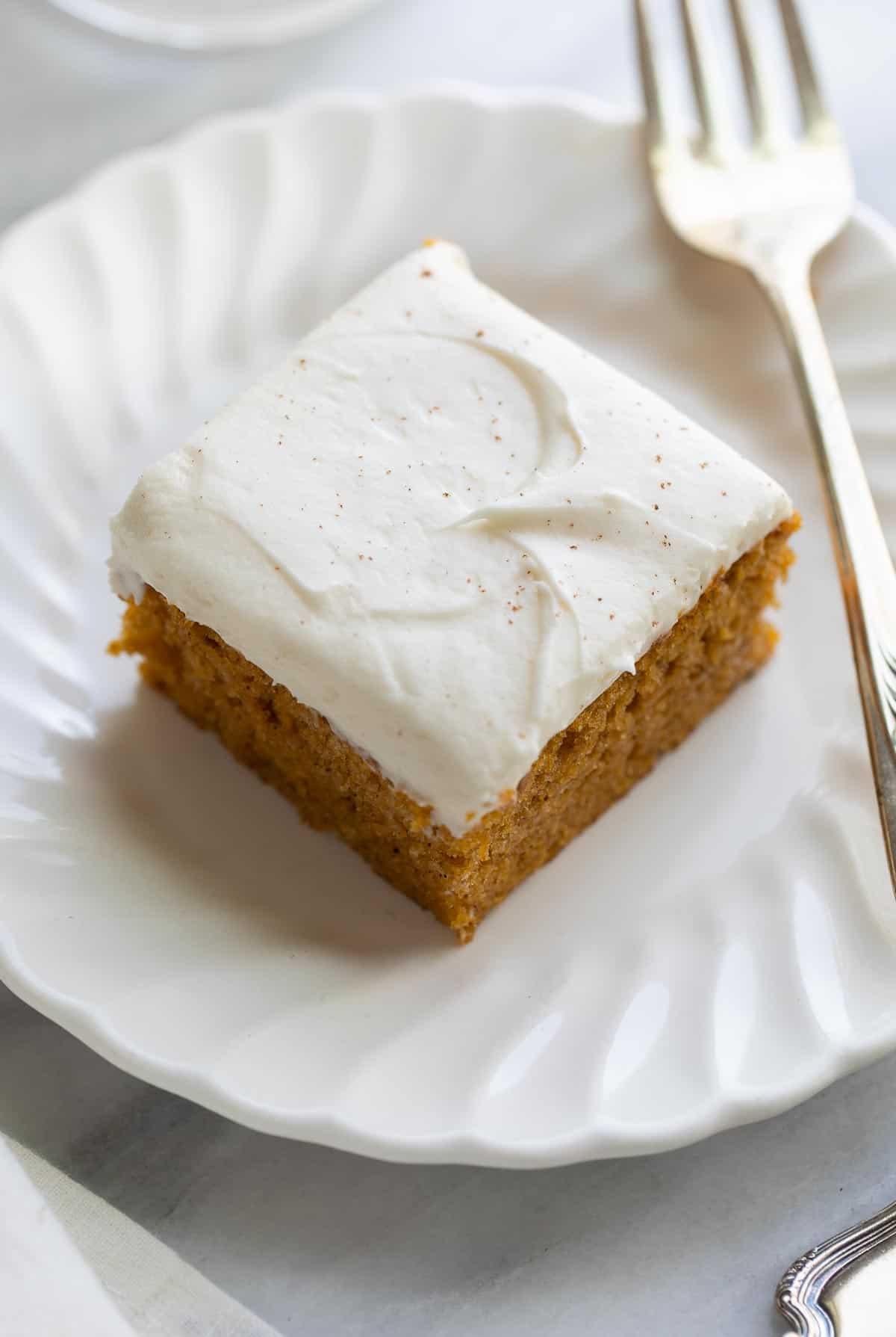 gluten free pumpkin bar on white plate with fork